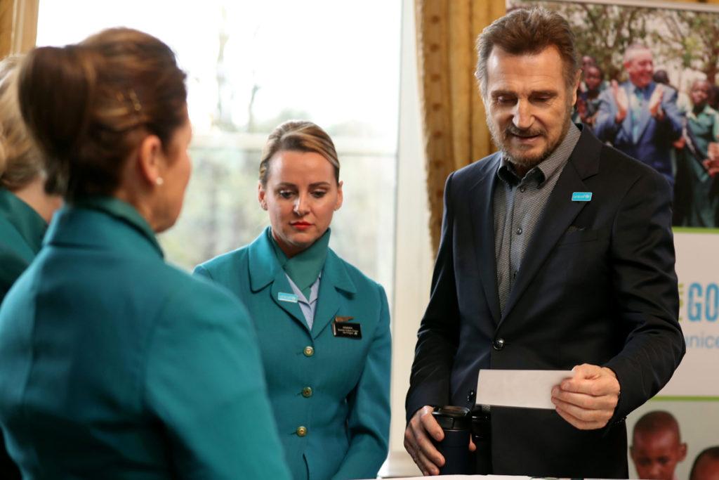 Liam Neeson with Aer Lingus cabin crew Sandra Sheehan