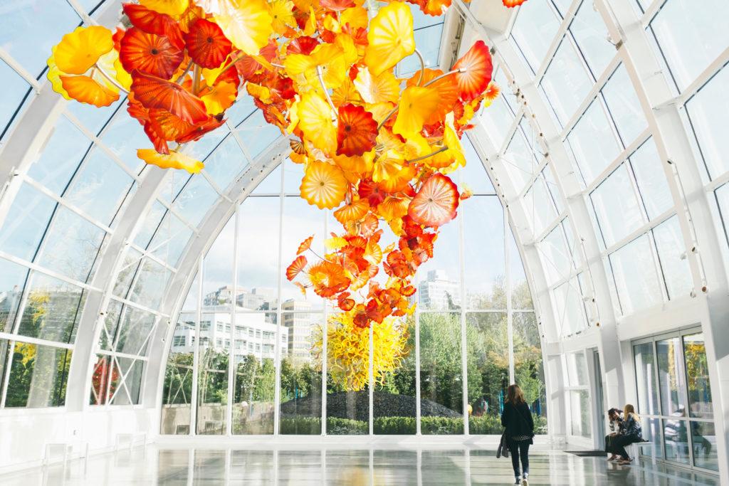 people in a glass garden exhibit